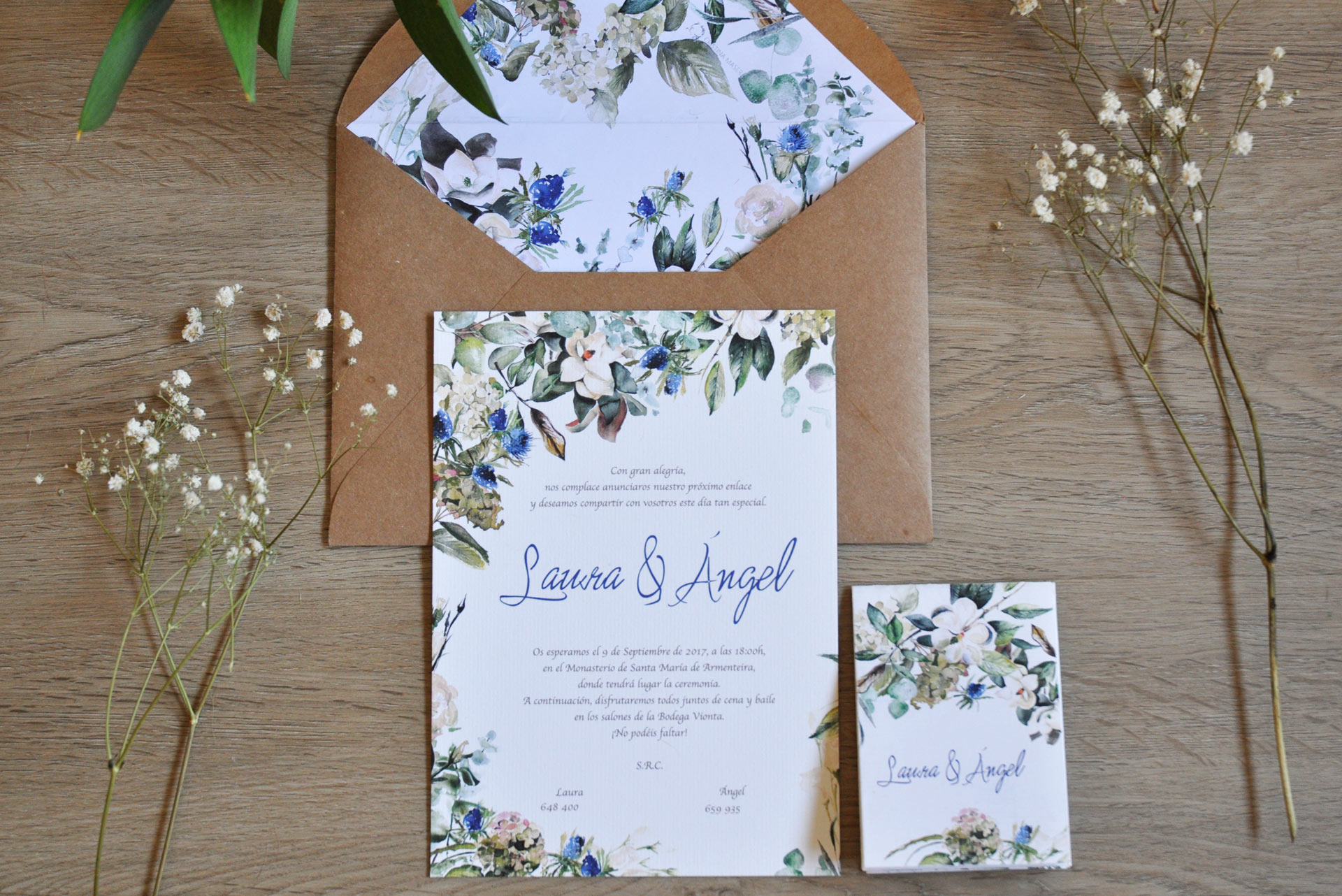 Wedding invitation with magnolias and thistles